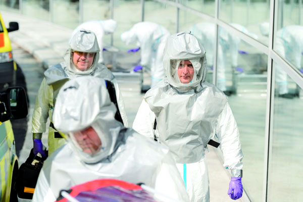 Biohazard medical team in protective uniform